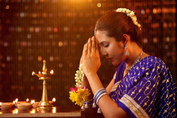 indian woman praying  to the lightQ