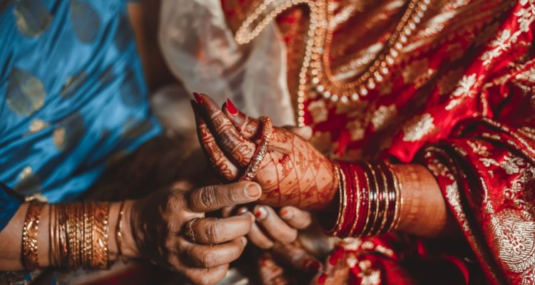 dowry system, Woman putting bangles on bride